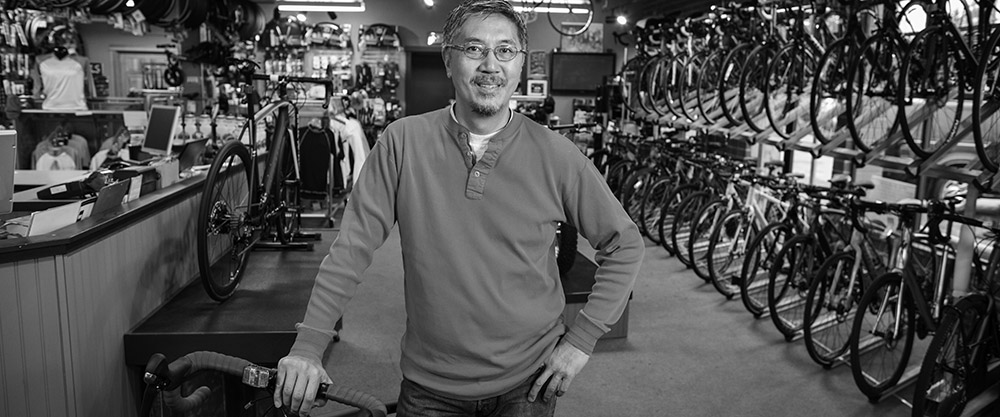Bicycle shop owner; image used for HSBC Fusion Get Rate page.