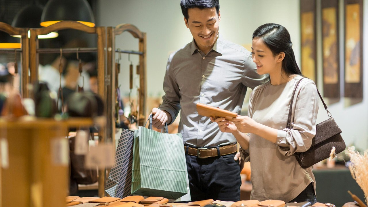 Young couple shopping in mall; the image used for spend wisely