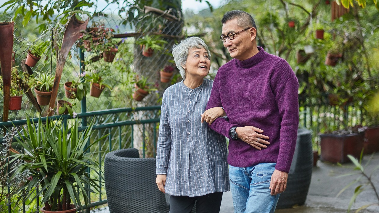 Elderly couple walking in the park; the image used for how to stay financially healthy